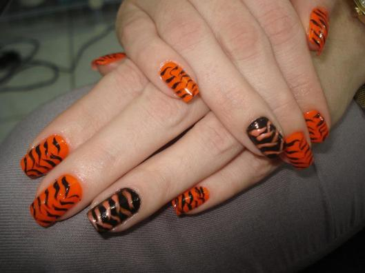 unha de tigre, unha tigresa, unha preta e laranja, unha filha unica, animal print,